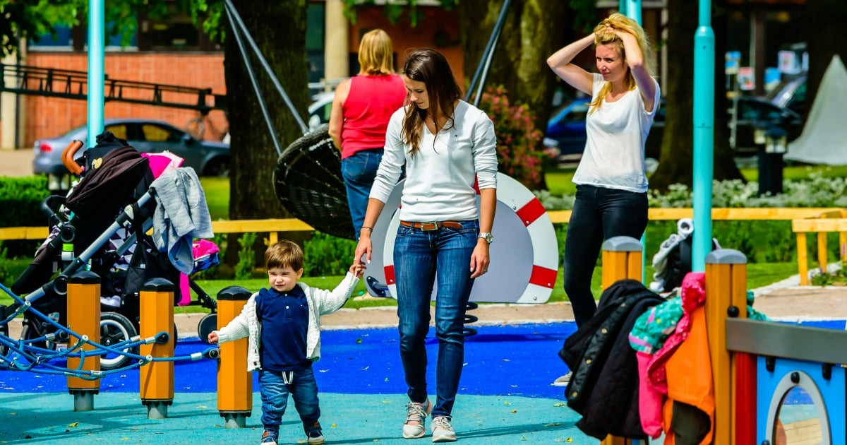 women and kids at the playground