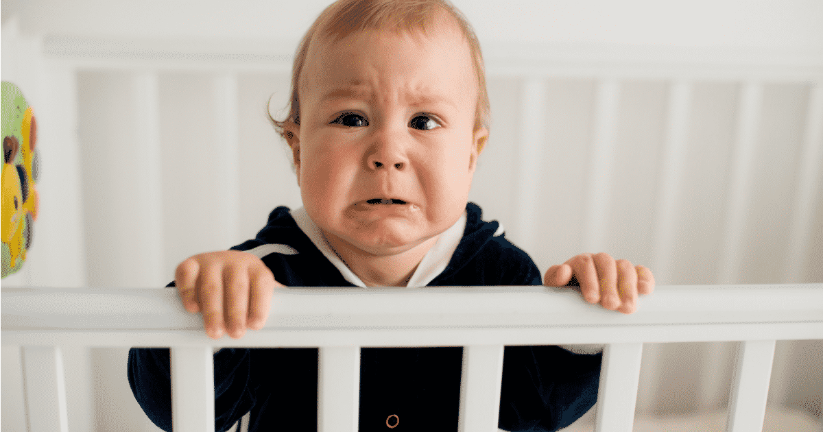 boy crying in crib