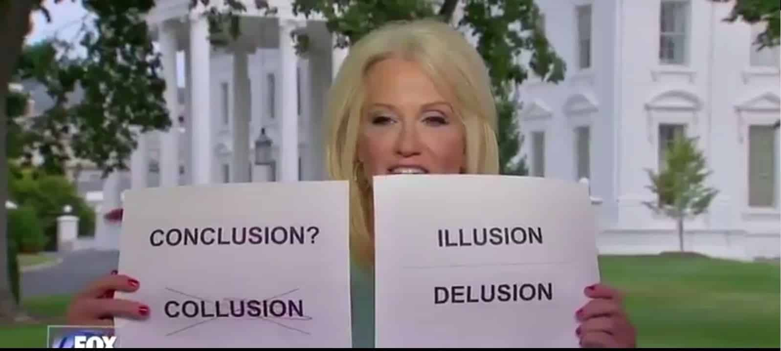 kellyanne conway holding up pieces of paper