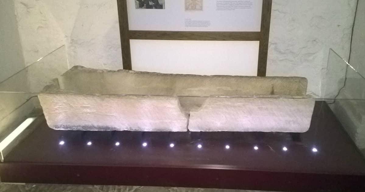 child breaks museum coffin