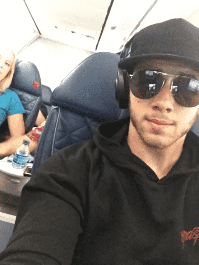 Nick Jonas on a plane!