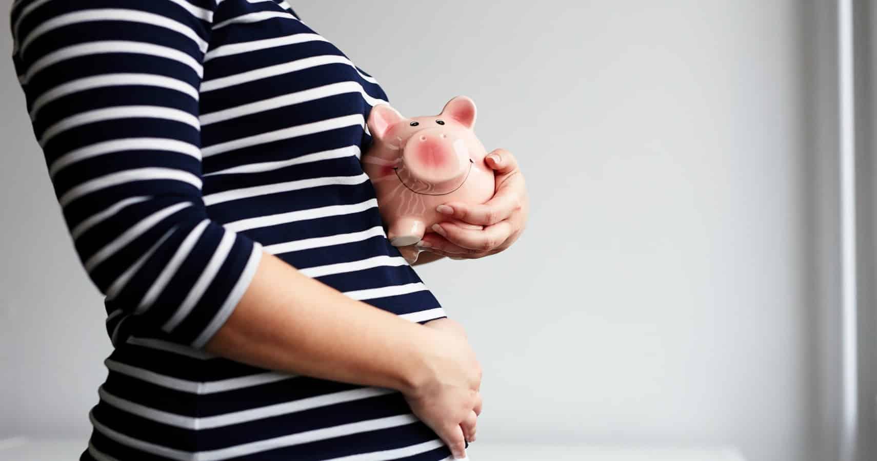 pregnant woman piggy bank