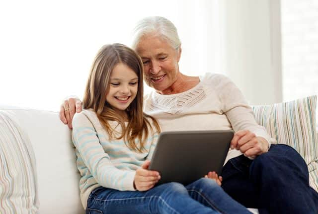 grandma and granddaughter reading