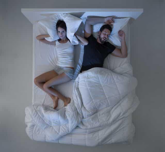 woman upset husband sleeping snoring