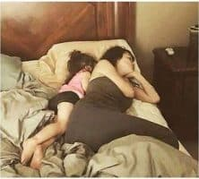 co-sleeping at the edge of the bed