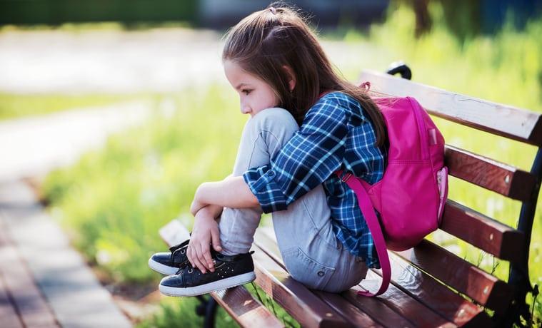 child sad backpack