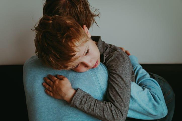 child sad hug
